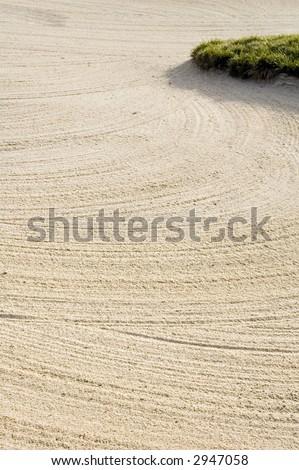 Rake marks in sand of fairway bunker on golf course - stock photo