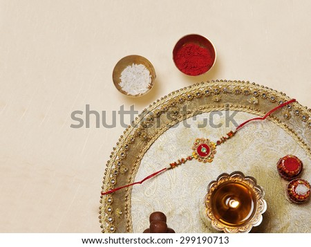 Rakhi and diya in a tray - stock photo