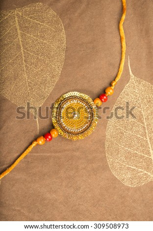 Rakhi or Rakshabandhan- an Indian Traditional Festival. Traditional Rakhi (wrist band) placed on a decorative paper. - stock photo