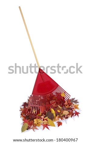 Raking up a pile of leaves - stock photo