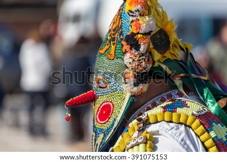 RAKOVSKI, BULGARIA - FEBRUARY 06, 2015 - Kukeri festival in Rakovski, Bulgaria. People dressed in different costumes dance and preform rituals to scare the evel spirits. - stock photo