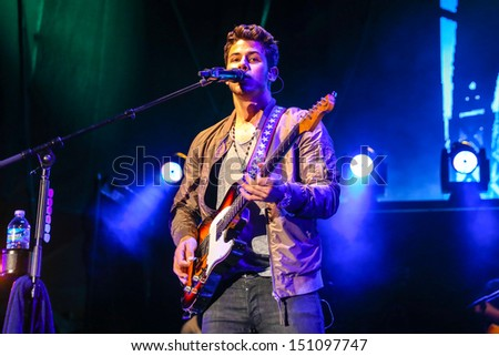 Raleigh, NC - July 31:  Nick Jonas of The Jonas Brothers perform a concert on their 2013 Jonas Brothers Live Tour on July 31, 2013 in Raleigh, NC. - stock photo