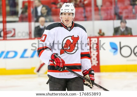 RALEIGH, NC - NOV 29, 2013:  New Jersey Devils center Ryan Carter (20) during the NHL game  - stock photo