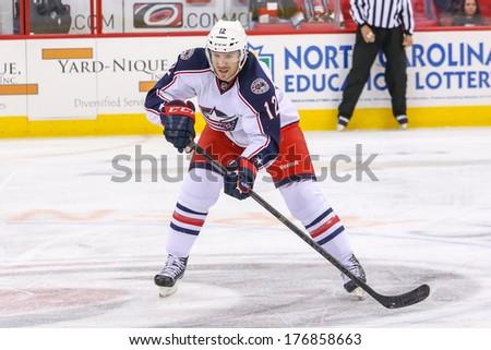 RALEIGH, NC - September 18, 2013: Columbus Blue Jackets center Ryan Craig (12) during the NHL pre-season game  - stock photo