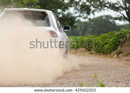 Rally Car speed in dirt road - stock photo