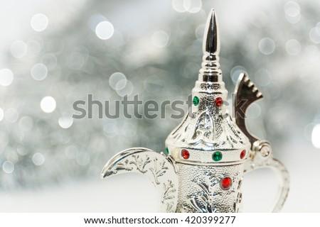 Ramadan, Eid background. Silver color arabic coffee pot - stock photo