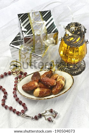Ramadan gift with dates and lantern - stock photo