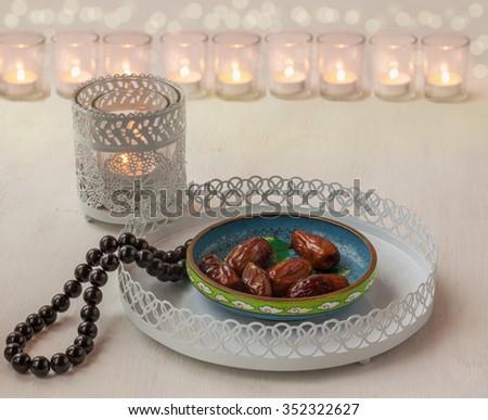 Ramadan lamp and dates on a white iron tray - stock photo