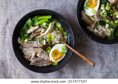 Ramen with pork, pak choi and egg - stock photo