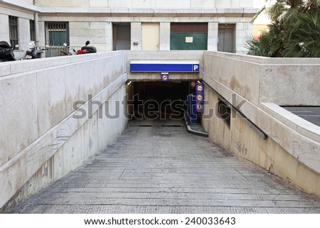 Ramp access  to underground public parking garage - stock photo