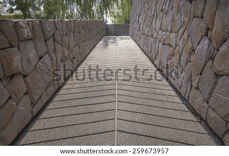 Ramp leading up with stoned wall around - stock photo