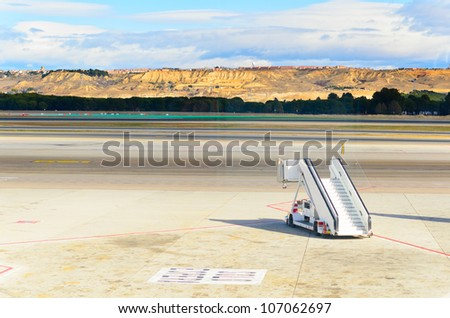 ramp standing on field at Barajas airport, Madrid, Spain - stock photo