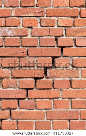 ramshackle house wall with a crack in the middle  - stock photo