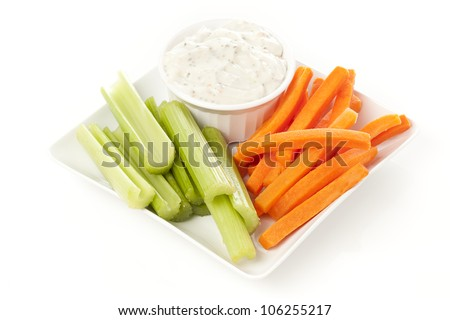 Ranch dressing with fresh carrots and celery - stock photo