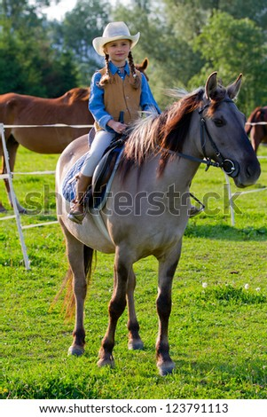 Ranch, horse riding - Portrait of lovely girl on a horse - stock photo