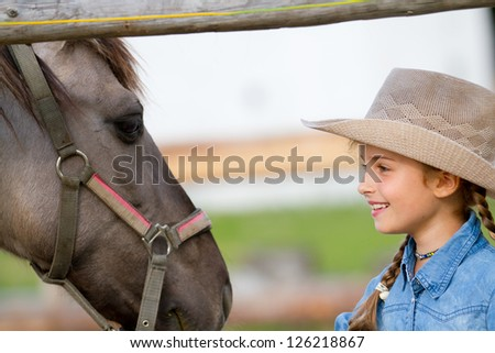 Ranch - Lovely girl with horse on the ranch, horse whisperer - stock photo