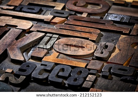 random collection of antique letterpress printing blocks - stock photo