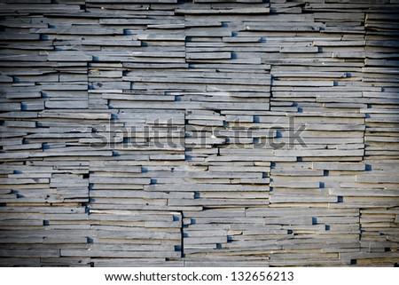 random slate stone wall, grungy style - stock photo