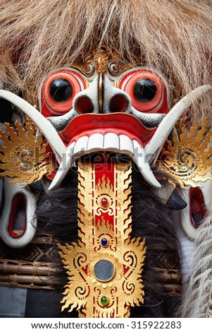 Rangda spirit - demon queen of Bali island, is featured in tourist attraction - traditional Balinese Barong dance.  Arts, religion and culture festivals of Indonesian people. Asian travel backgrounds. - stock photo