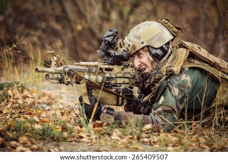 Ranger aim at a target of weapons - stock photo