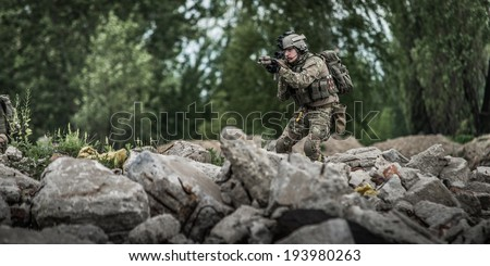 ranger during patrol in city ruins - stock photo