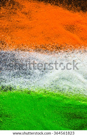 Rangoli powder in tricolors.. Abstract Indian Republic day background. - stock photo