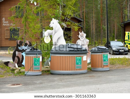 RANUA, FINLAND - JULY 10, 2015: There are trash bins with figures of animals in holiday village Gulo Gulo near Ranua zoo . Animals show in what tanks to throw out different garbage - stock photo