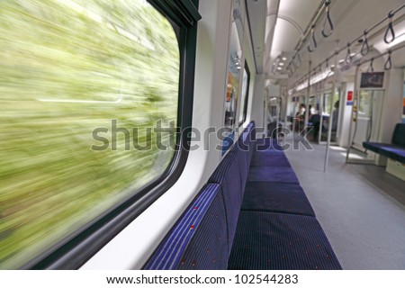 Rapid motion view of a green scenery from a high speed train window. - stock photo