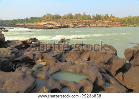 Rapids in the river. - stock photo
