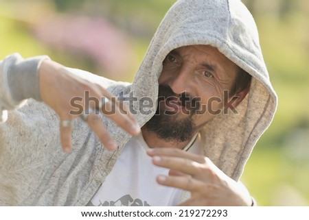 Rapier wearing hood - stock photo