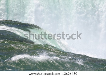 Rare close up detail of Niagara Falls (American falls at Horseshoe Bend) shot from the Terrapin Point, fast shutter speed to freeze the motion - stock photo