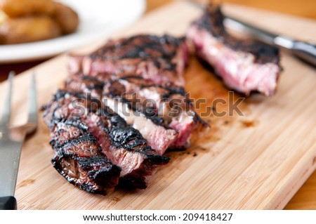 rare rib steak grilled to perfection - stock photo