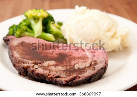 rare roast beef with vegetables, mashed potatoes and gravy - stock photo