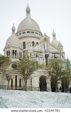 Rare snowy day in Paris. Basilica Sacre-Coeur and lots of snow - stock photo