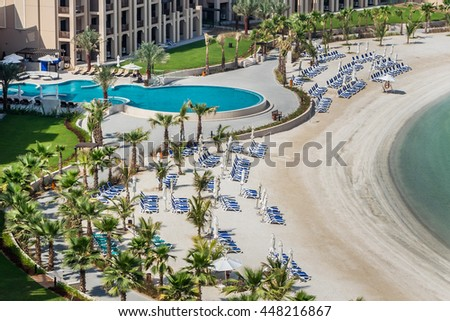RAS Al KHAIMAH, UAE - JUNE 27, 2016: Luxury 5 stars DoubleTree by Hilton Hotel Resort and Spa Marjan Island - 485 rooms, pools, beach, full-service spa. A lovely beach area - 650-meters of soft sands. - stock photo