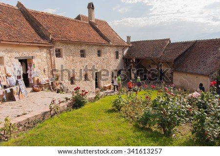 Rasnov, Romania - July 04, 2015: The stone, brick hut inside the medieval castle - stock photo