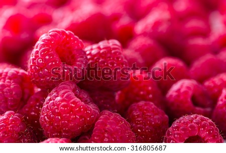 Raspberries as detailed close-up shot food background image - stock photo