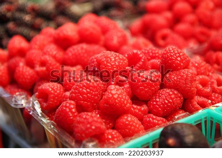 Raspberries in a basket - stock photo