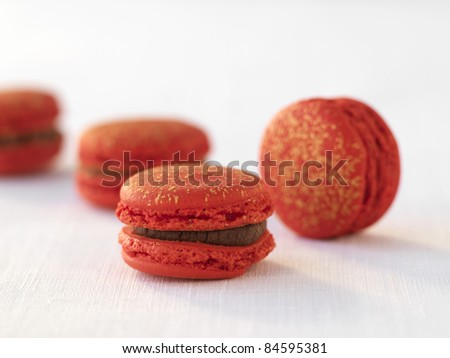 Raspberry and dark chocolate macaroons - stock photo