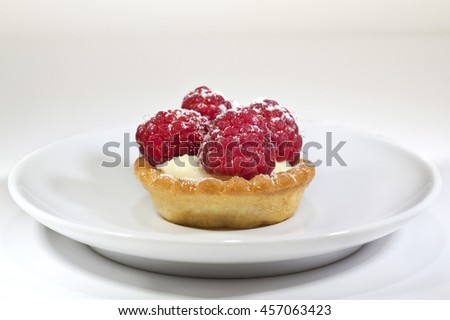 Raspberry cake on a plate in a tea room - stock photo