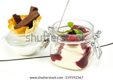 raspberry cream dessert in a glass jar - stock photo