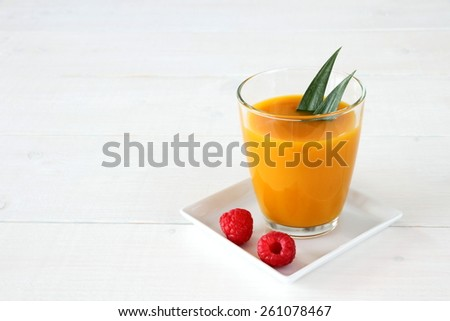 Raspberry, fruity mango smoothie made from ripe fruit, horizontal - stock photo