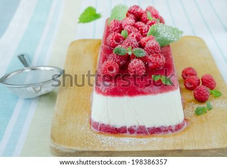 Raspberry ice-cream dessert; homemade semifreddo with mint on wood board  - stock photo