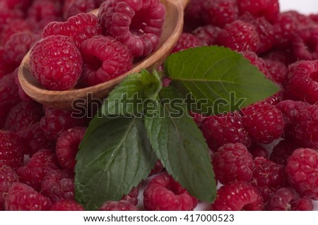 Raspberry in bowl on brown background - stock photo