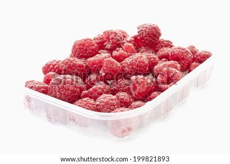 Raspberry in plastic container - stock photo