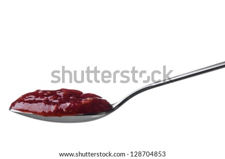 Raspberry jam in a spoon isolated on white - stock photo
