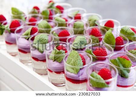 Raspberry mousse verrine, french glass dessert - stock photo
