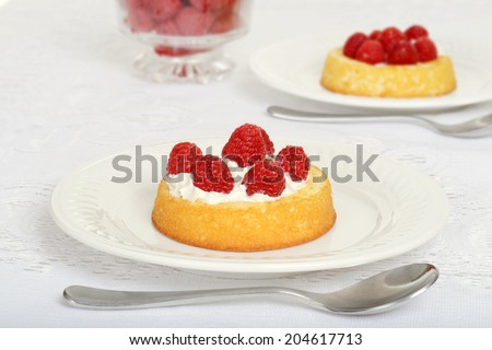 raspberry shortcake with a spoon - stock photo