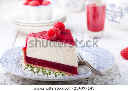 Raspberry tart, mousse cake, cheesecake with fresh raspberries on a white wooden background - stock photo