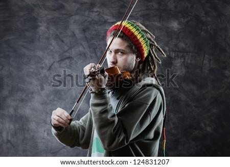 Rasta man musician playing violin - stock photo